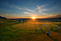 Dawn at the 2012 USGA Public Links Championship finds many players warming up and practicing their putting strokes.