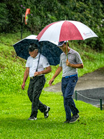 Gary Player and the Captain of The Hong Kong Golf Club on a rainy day.